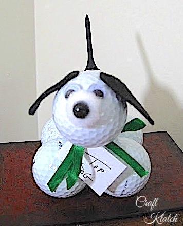 Golf ball dog