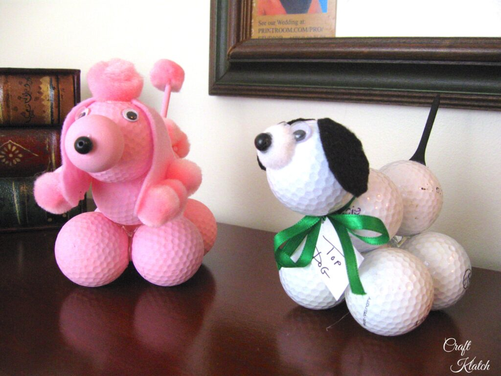 Pink golf ball poodle and white golf ball dog