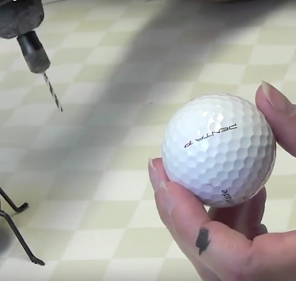 Use rotary tool or drill to drill holes into golf ball for the legs