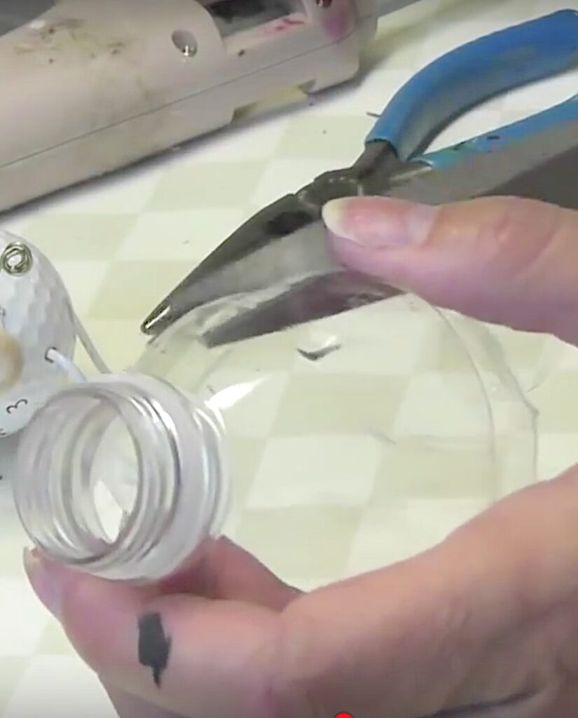 Cut wings out of recycled plastic bottles