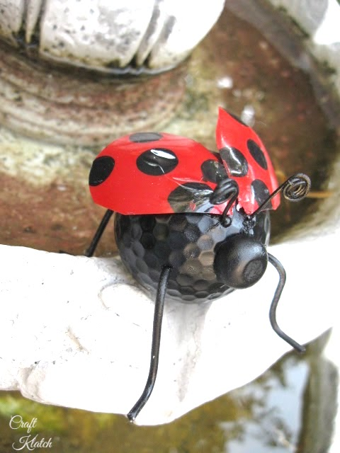 Finished ladybug craft on edge of fountain