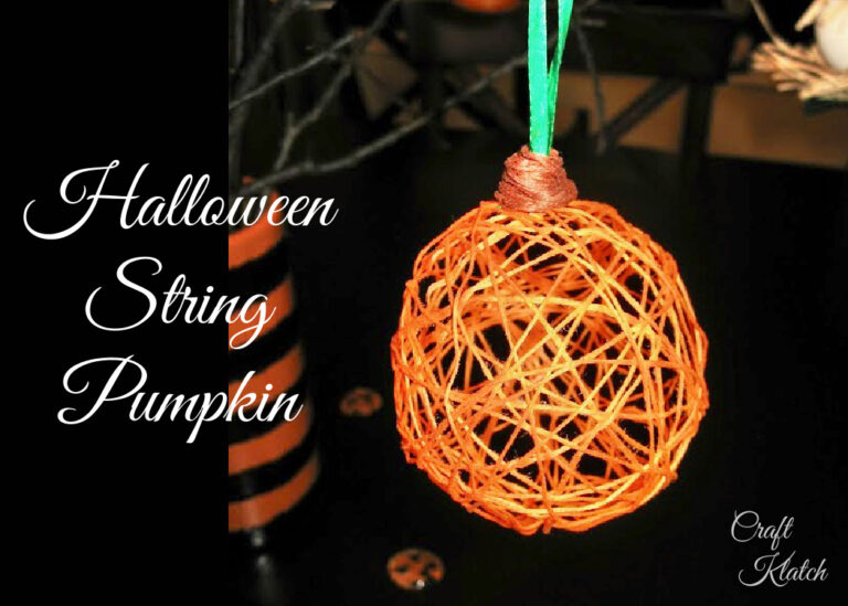 String pumpkin Halloween decoration hanging from a branch