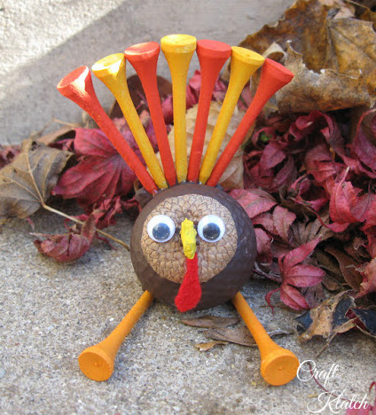 how to make a golf ball turkey finished project sitting by fall leaves