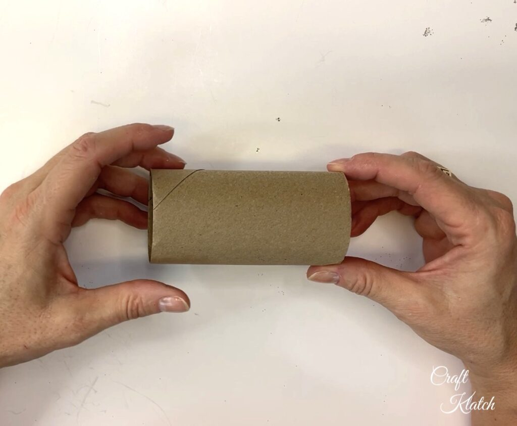 Holding empty toilet paper roll