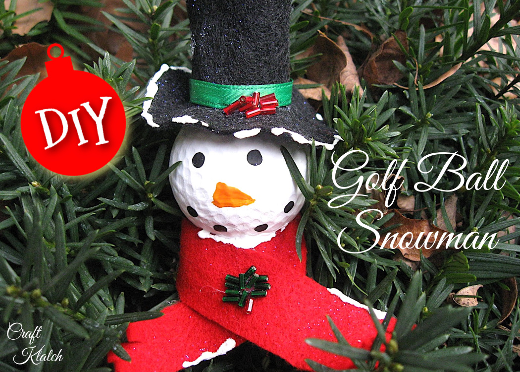 Golf ball snowman ornament craft with red scarf and black hat