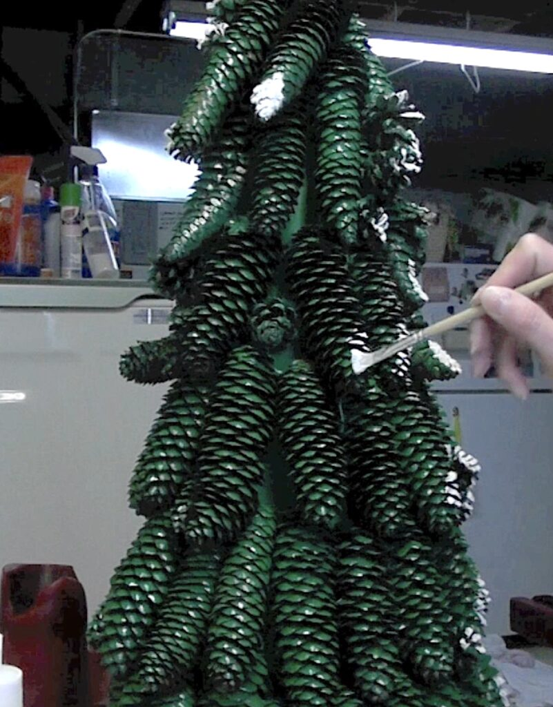 paint the tips of the pine cones white like snow