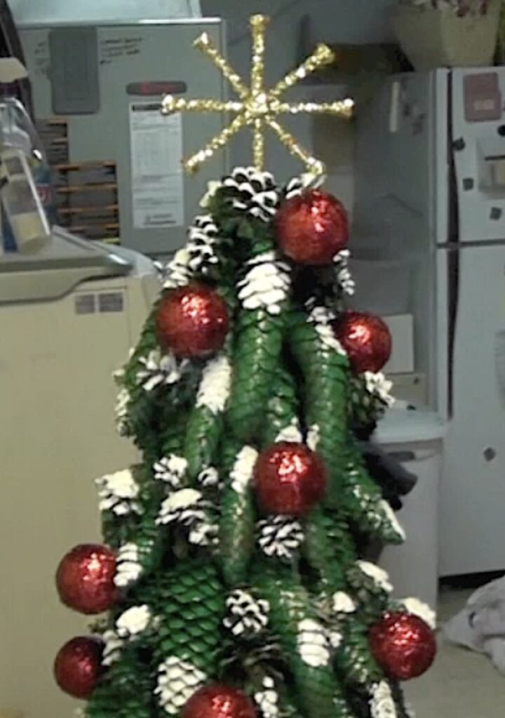 Add gold glitter golf tee star to the top of the pine cone Christmas tree