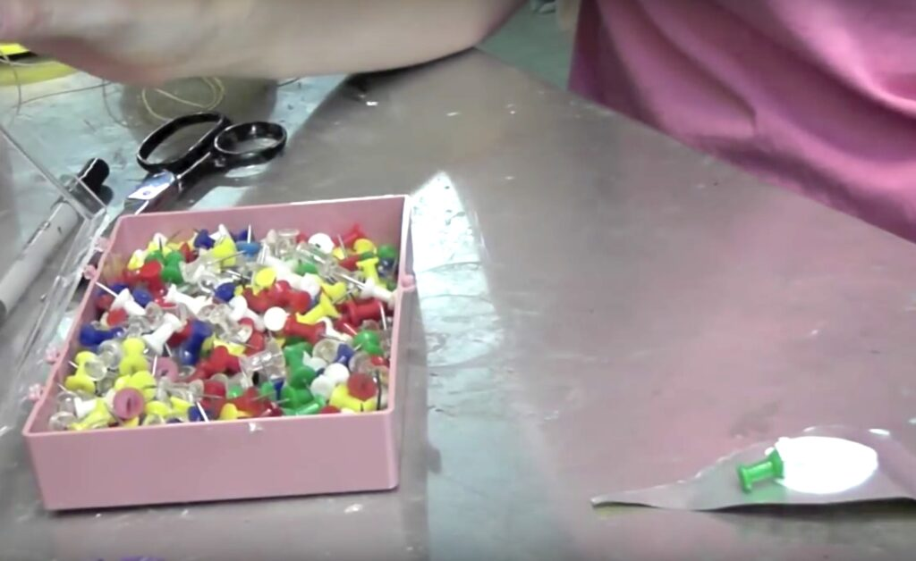Box of pushpins for recycled flower garden art craft