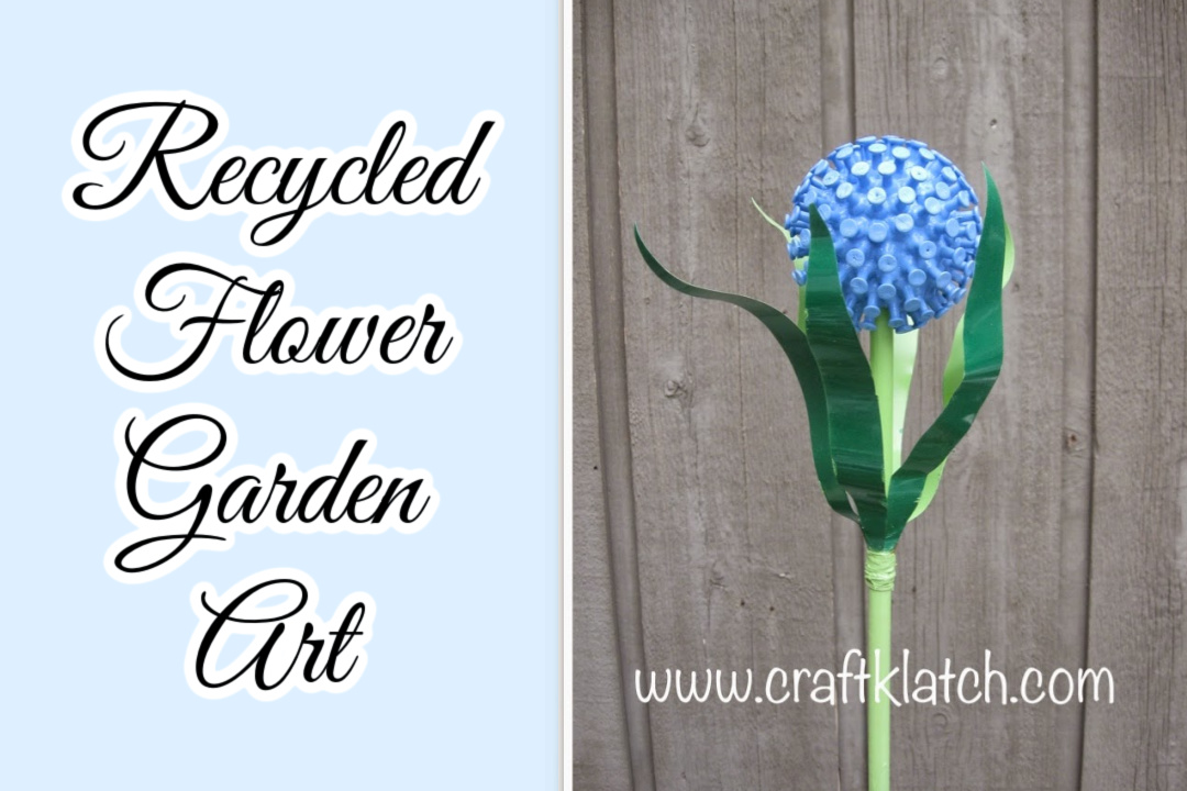 Recycled flower garden art blue flower and green stem and leaves
