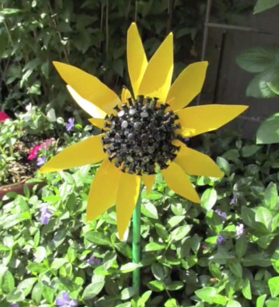 Recycled sunflower craft in garden