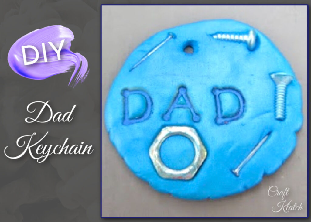 Round, blue Dad keychain with nuts and screws embedded