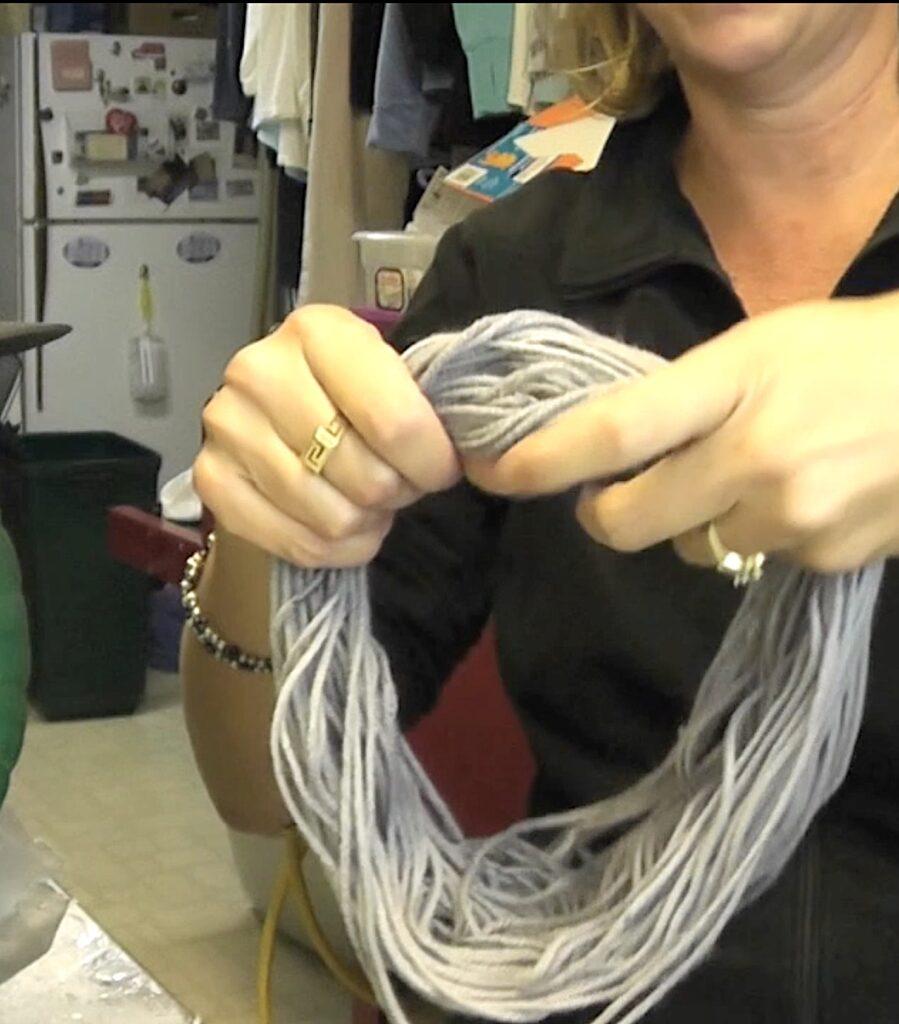 Make a loop of gray yarn
