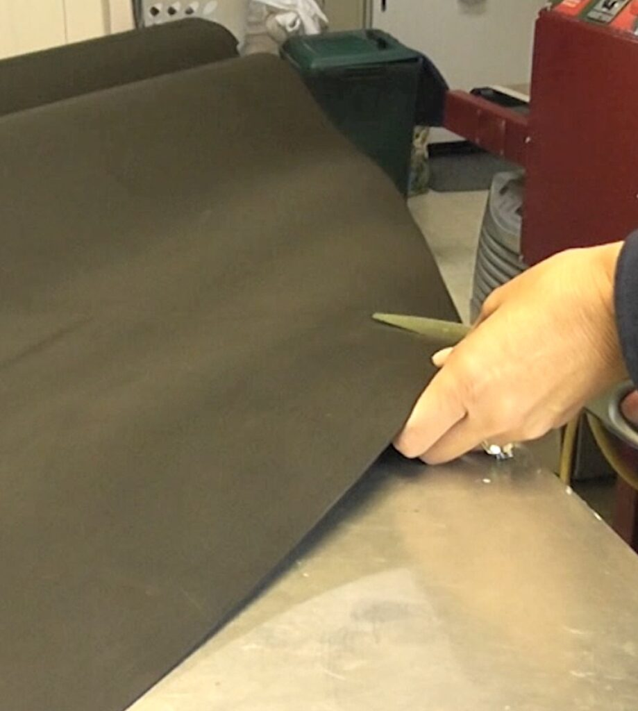 Cut black foam along pencil line for cone