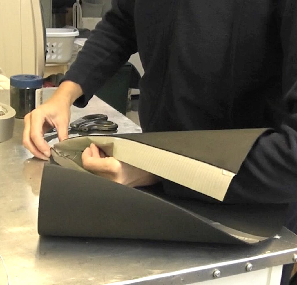 Roll the foam into a cone securing it with duct tape