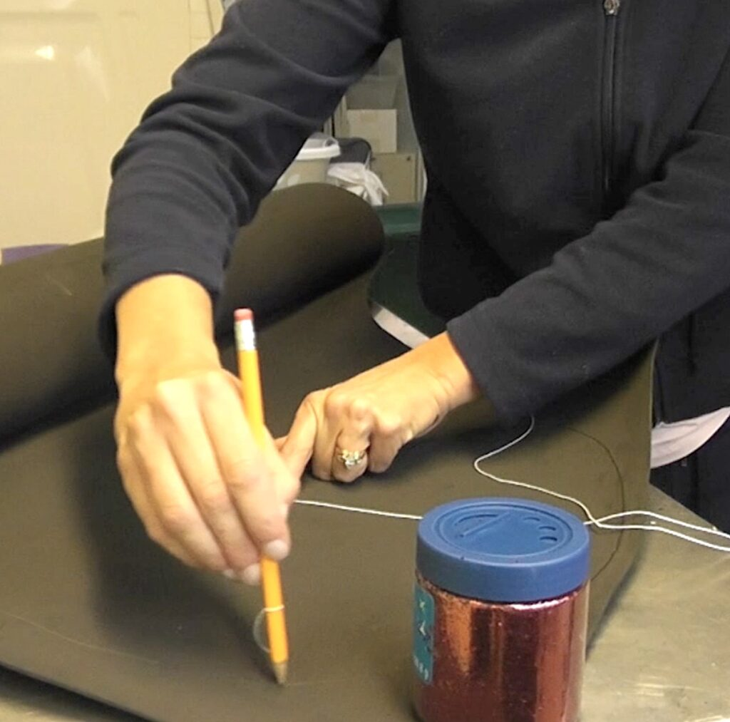 Use string and pencil to draw a circle on the foam