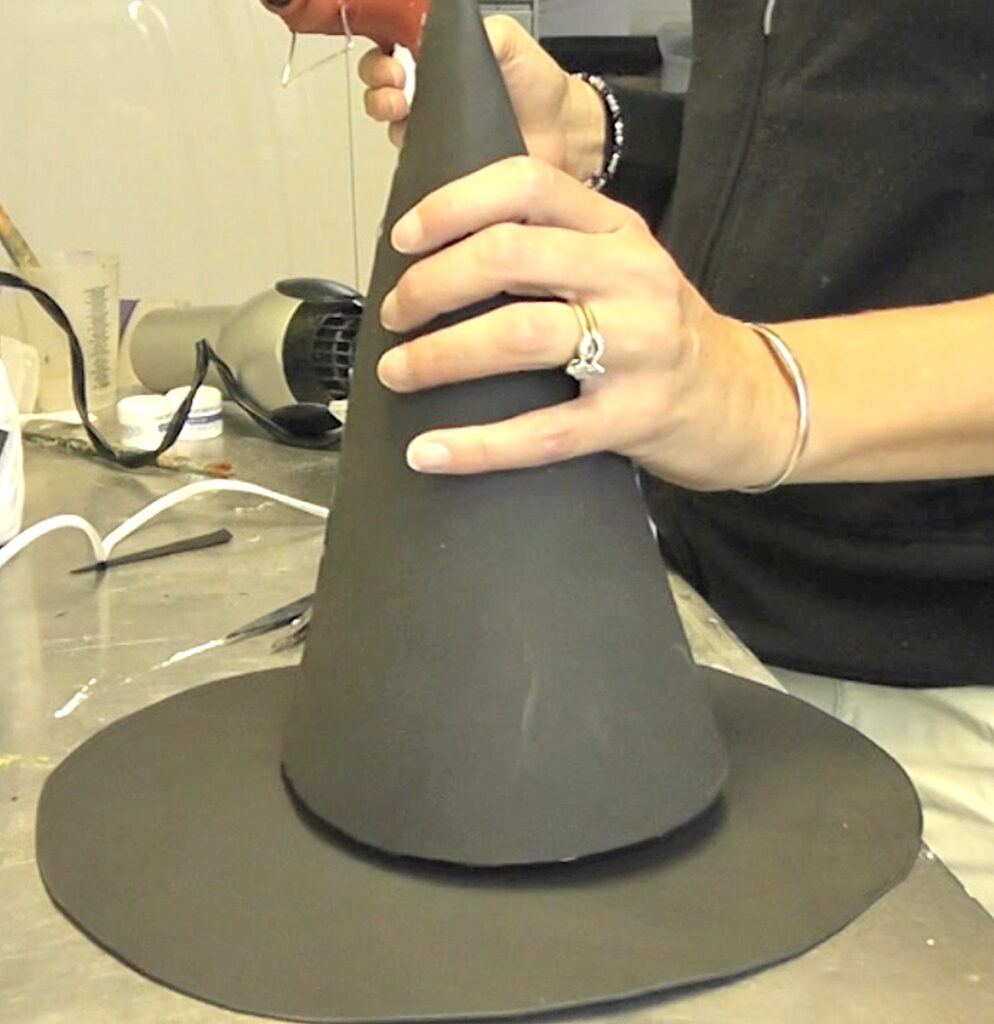 Glue cone onto the top of the witch hat brim