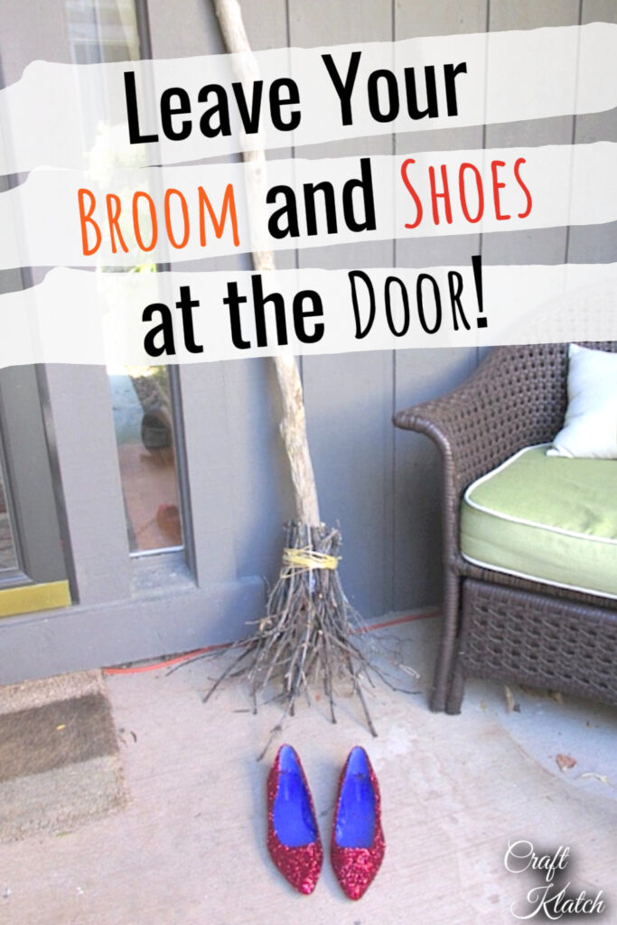 Witch's broom leaning at door with red slippers