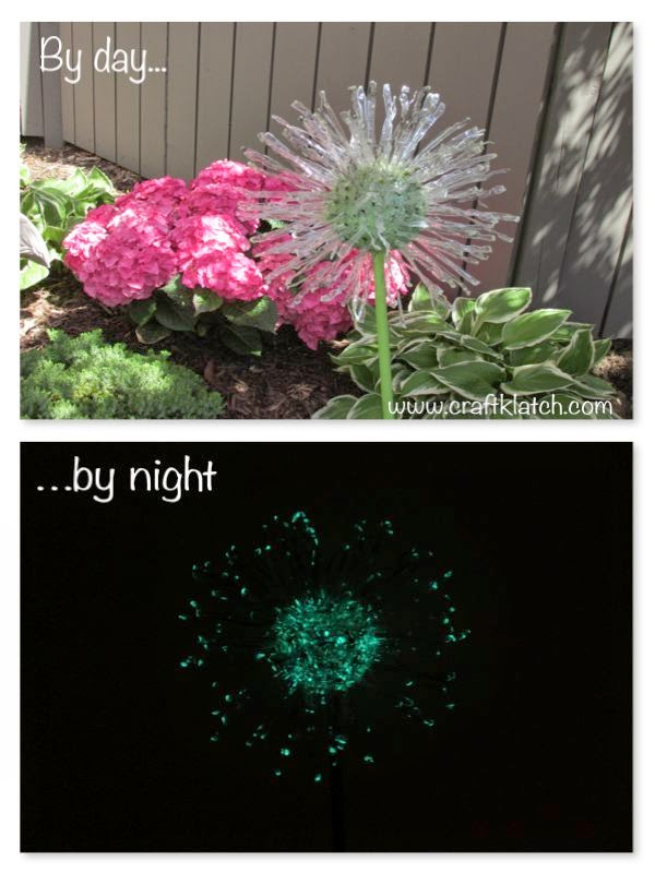 Recycled dandelion yard art. View by day and glow-in-the-dark by night.