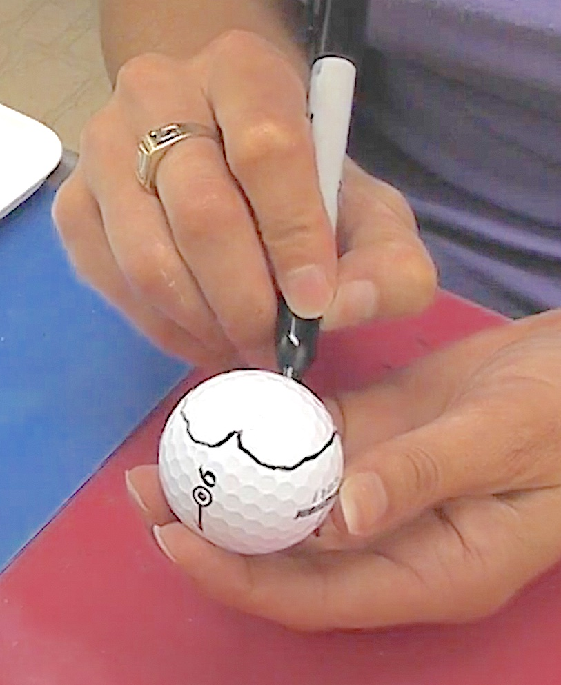 Draw a heart on the golf ball