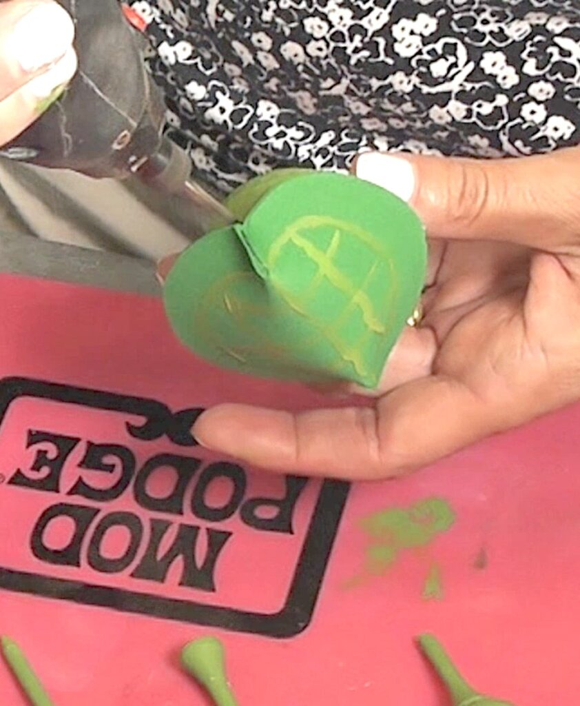 Drill hole into golf ball for the turtle head