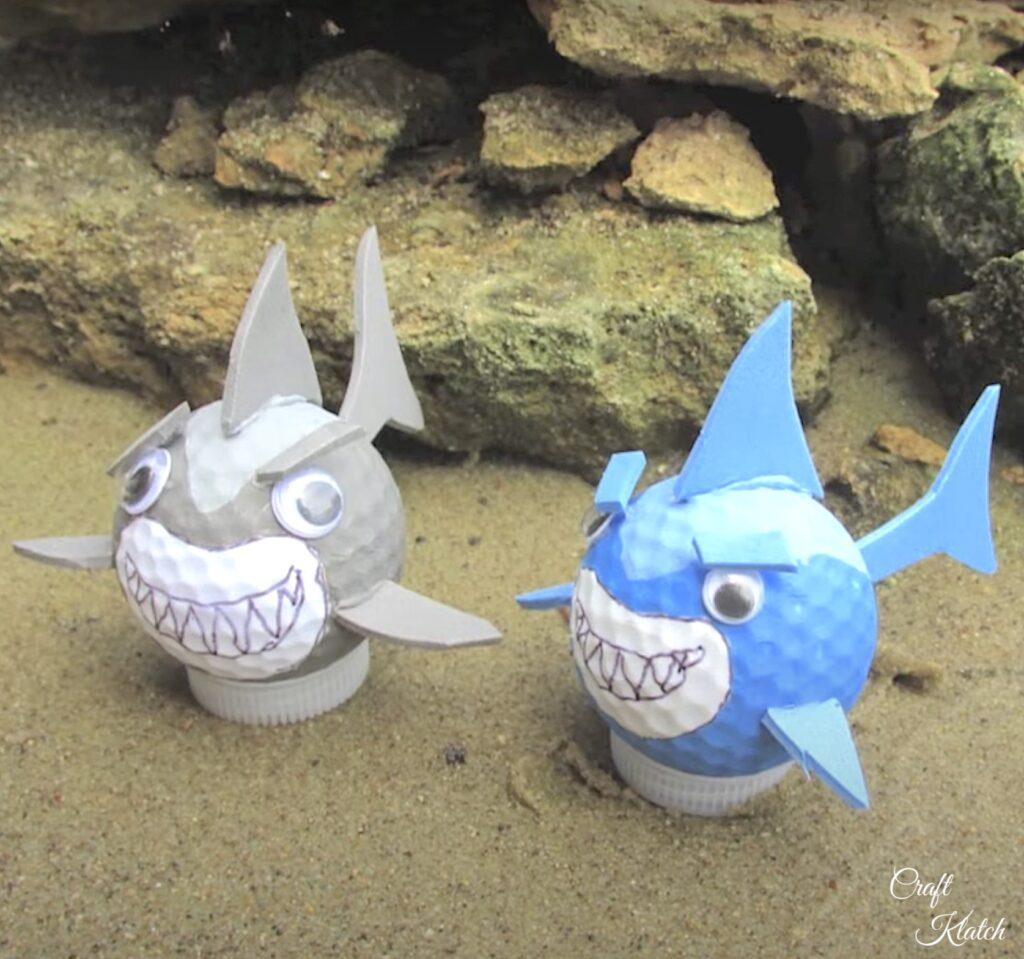 Golf ball sharks sitting in sand craft diy