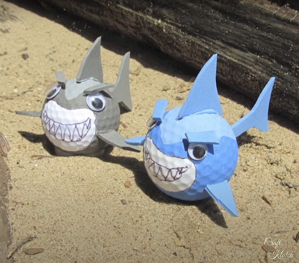 How to make golf ball sharks two golf ball sharks sitting in sand craft DIY