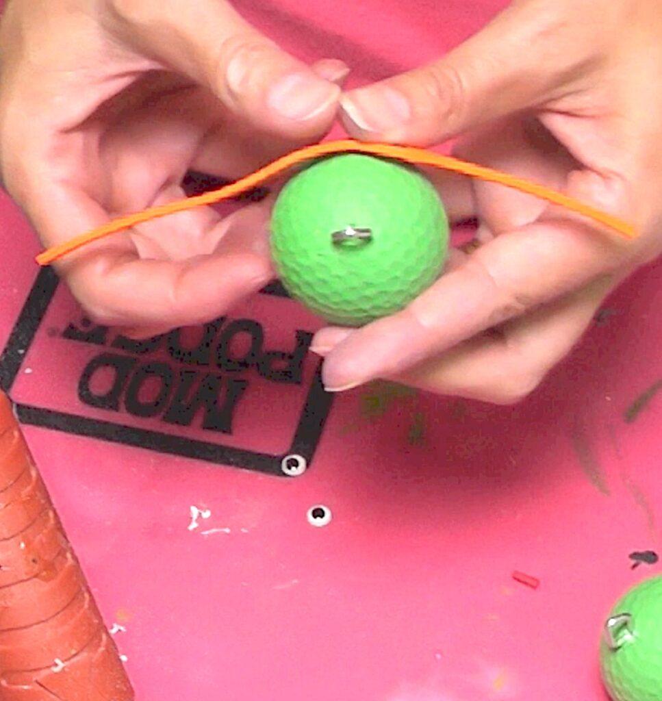 Add orange mask to green golf ball for teenage mutant ninja turtles keychains