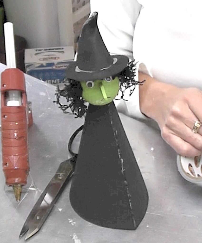 Place the witch head on the foam cone