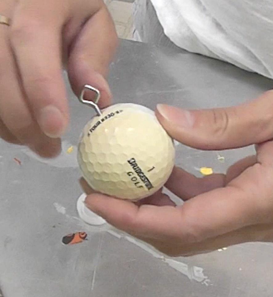 screw in eye screw into golf ball