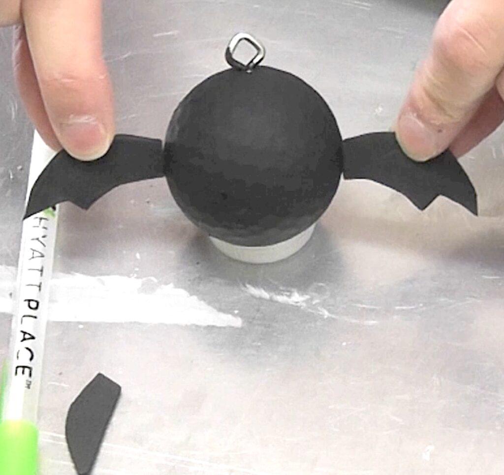 Cut black bat wings out of craft foam