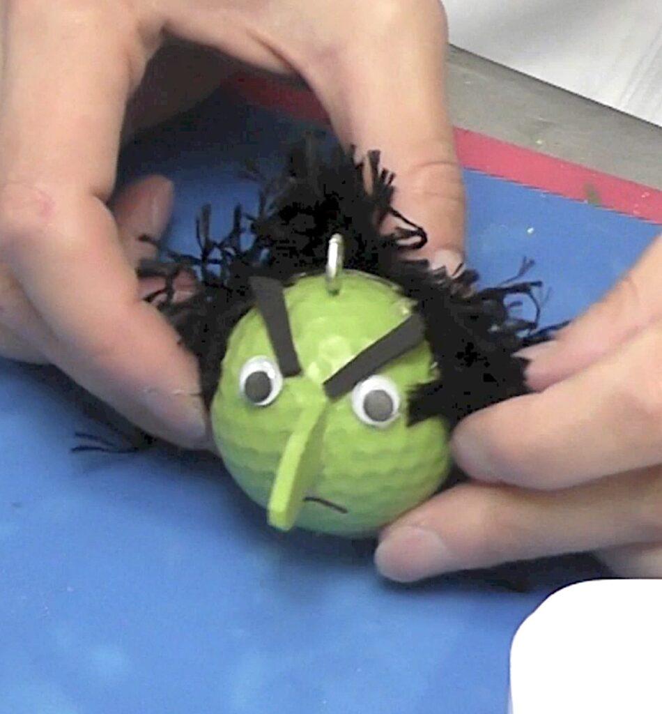 Glue on black fringed trim for hair
