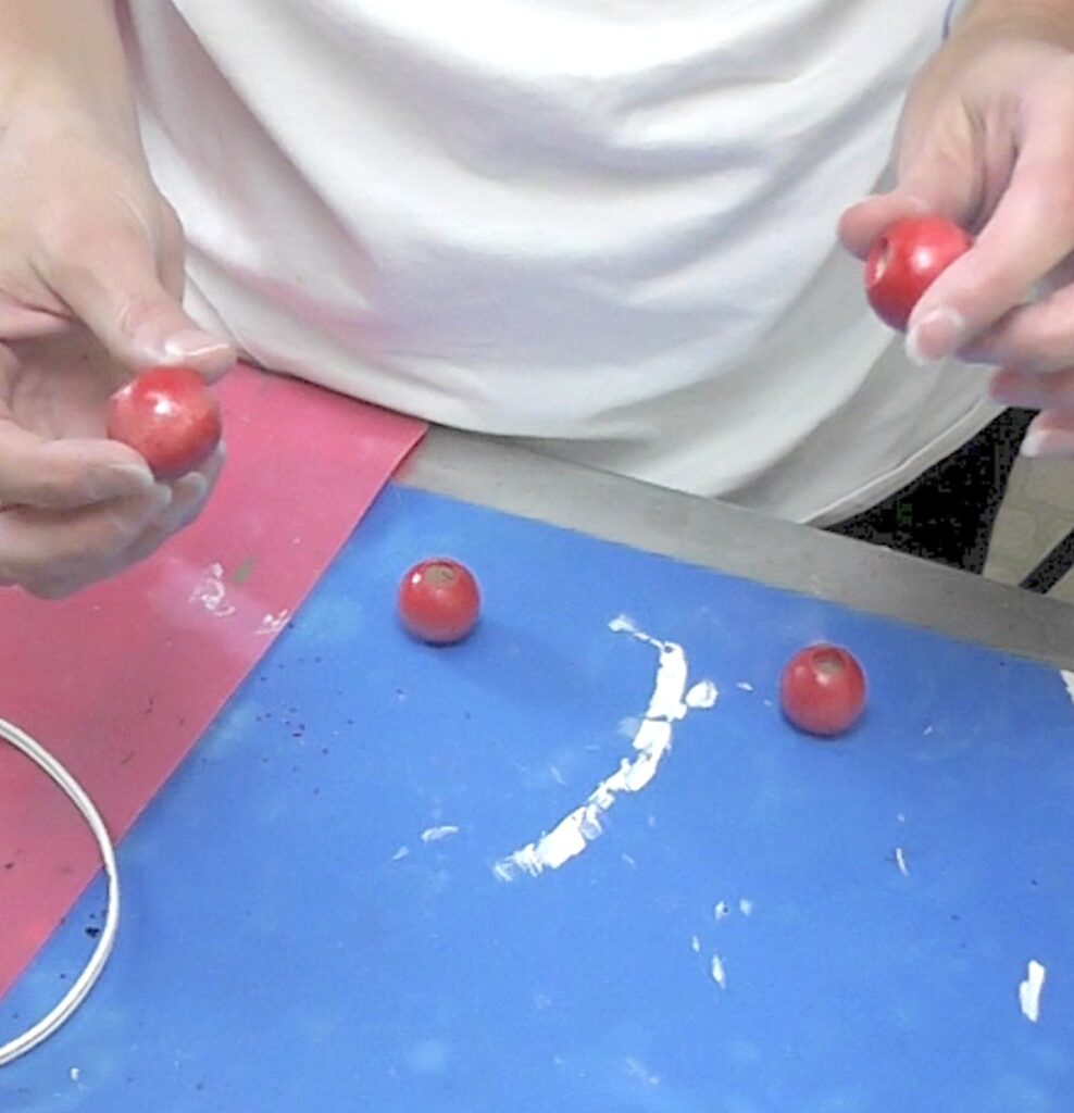 Paint and seal the dowel caps red