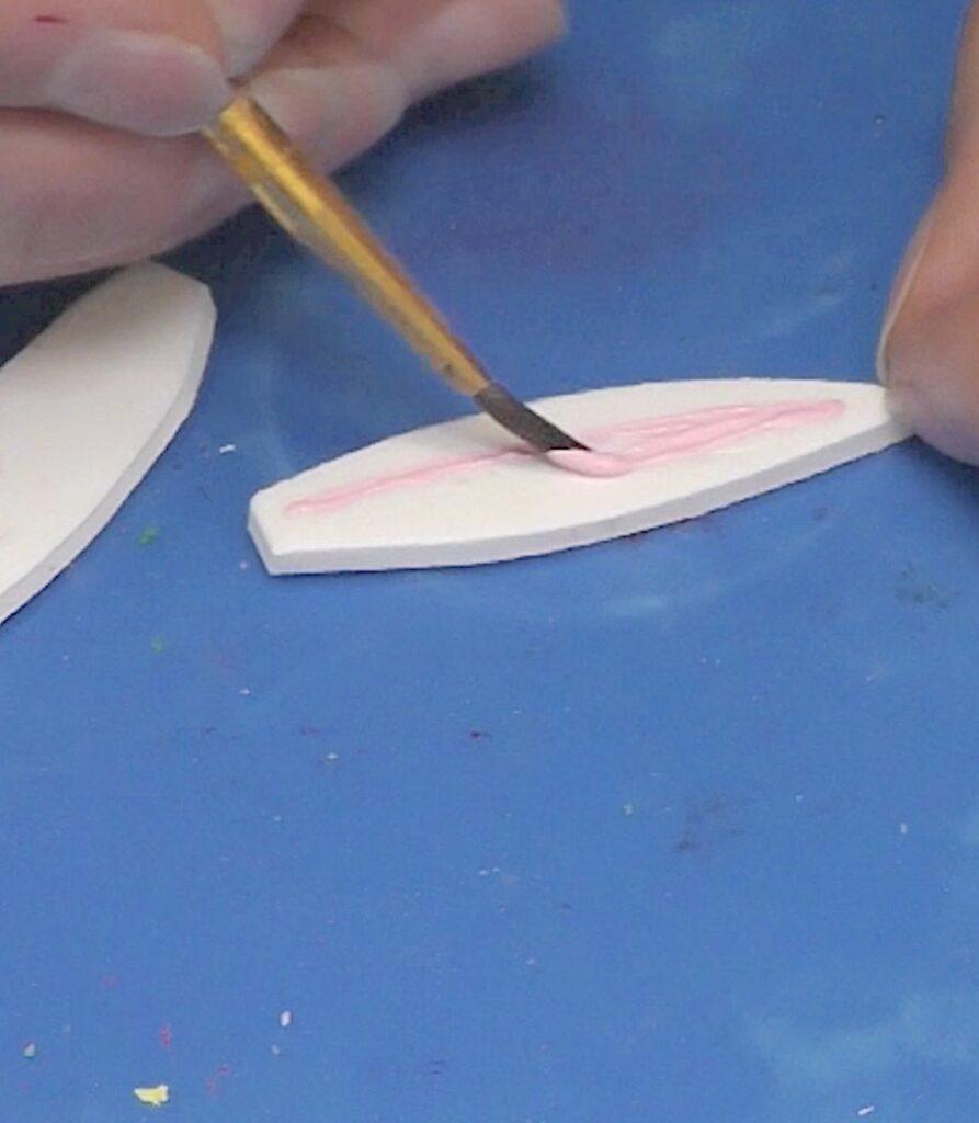 Paint inner ear pink on white foam bunny ears