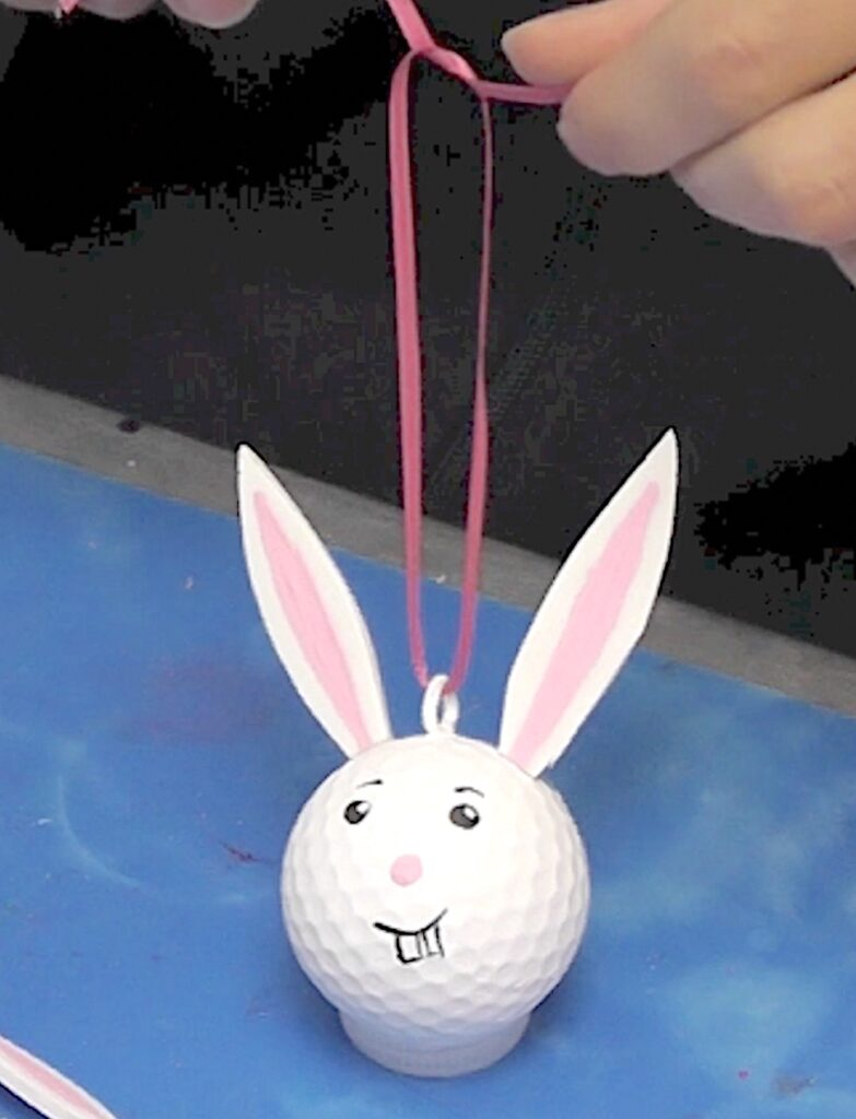 Add ribbon to hang the golf ball bunny