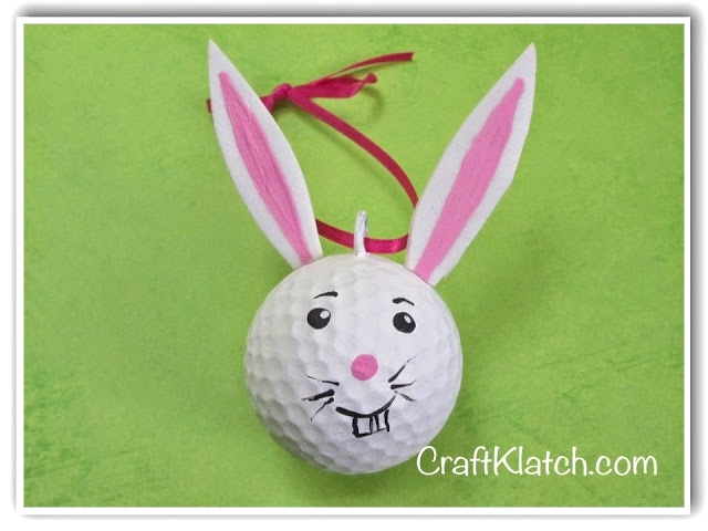 Golf ball bunny with red ribbon