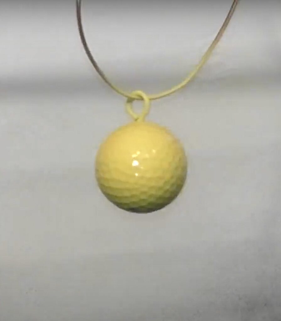 suspend golf ball and spray paint it yellow
