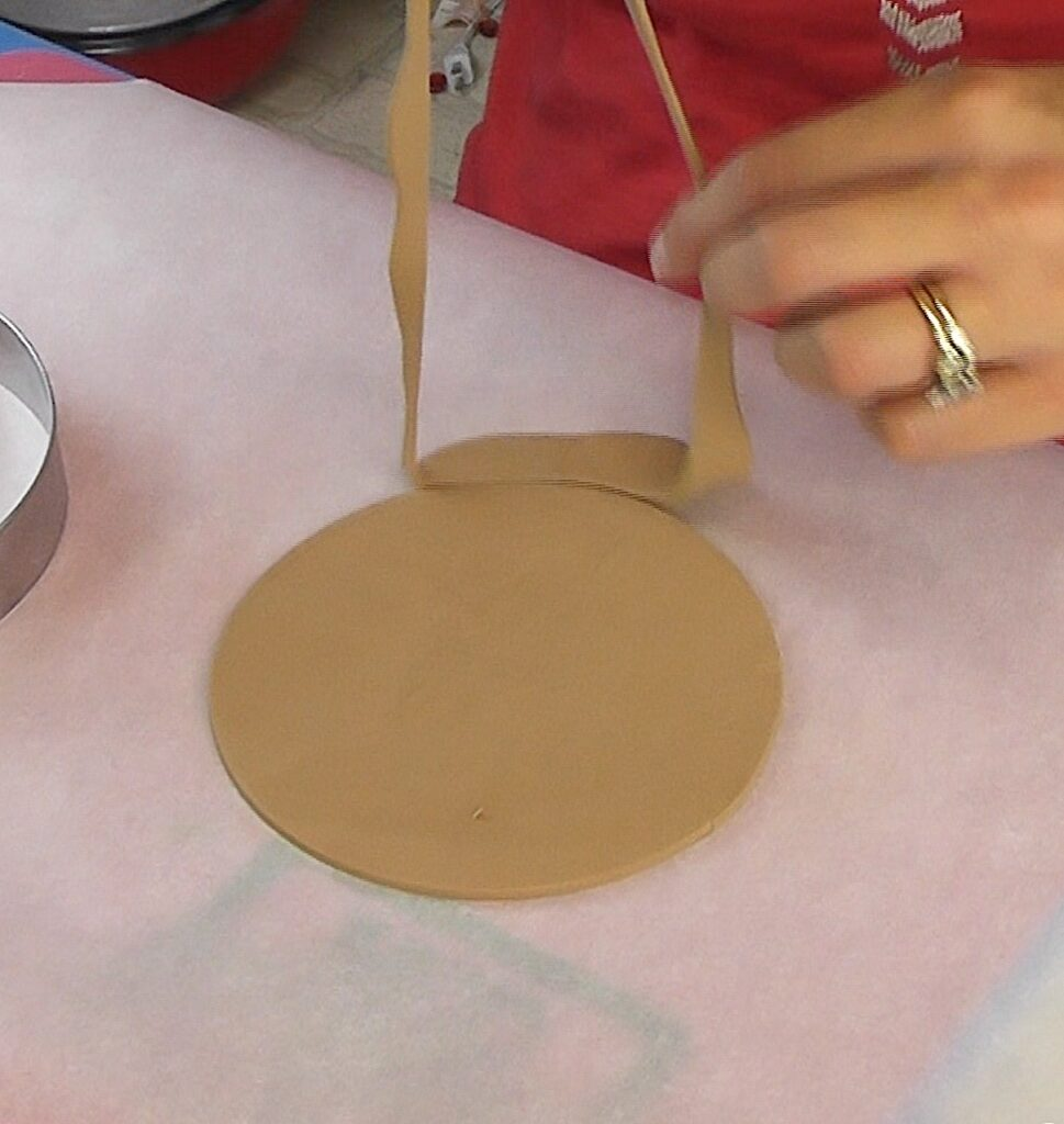Remove the excess clay from around the circle cookie cutter