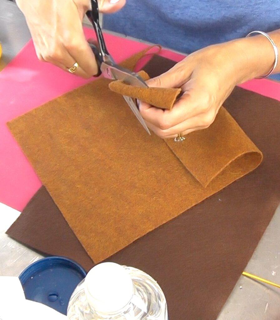 cut corner of the folded felt