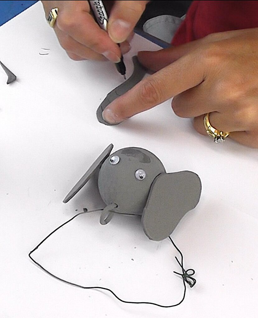 Draw on bend marks for elephant trunk