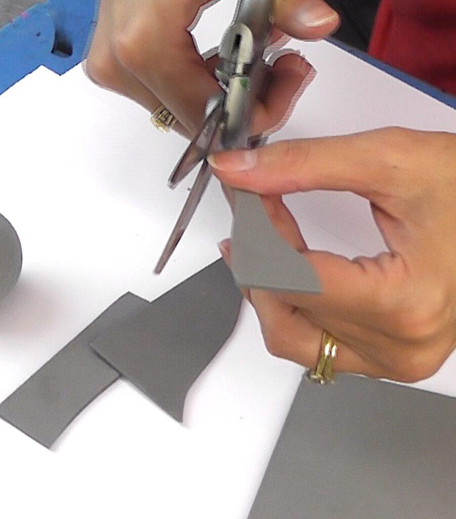 Cut out an elephant trunk shape from gray craft foam