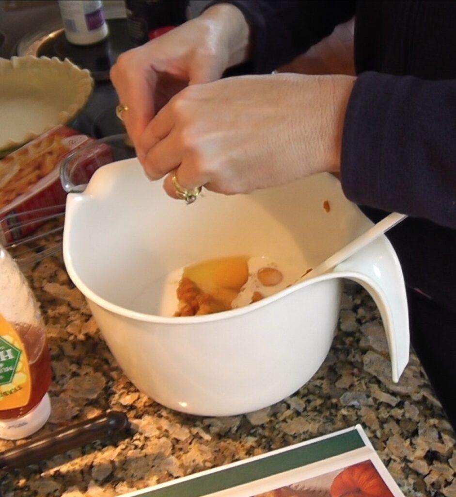 Pumpkin pie - Adding pumpkin pie ingredients into bowl