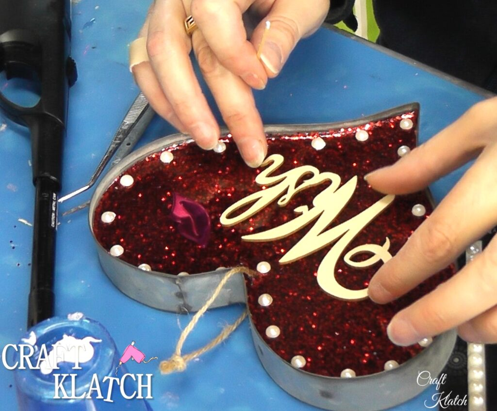 Pearls and wish added to metal and resin red glitter heart