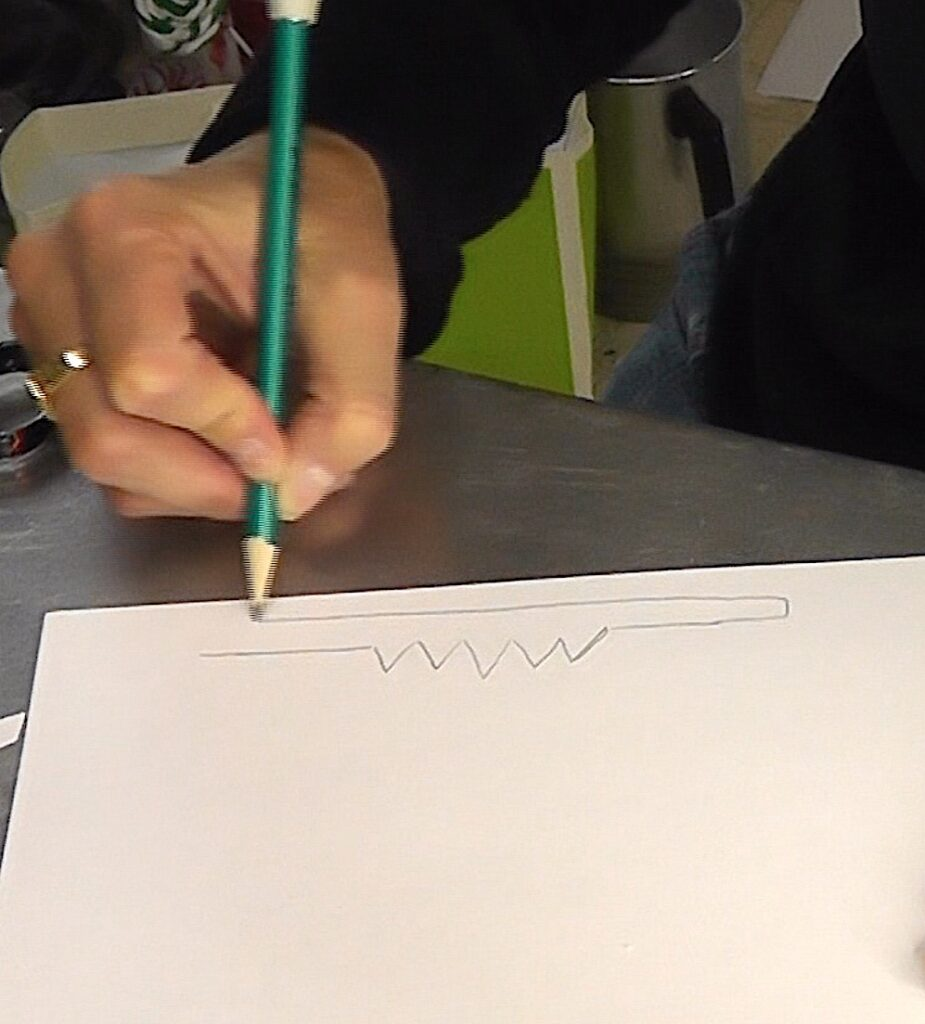 Draw a crown outline onto a piece of cardstock or posterboard