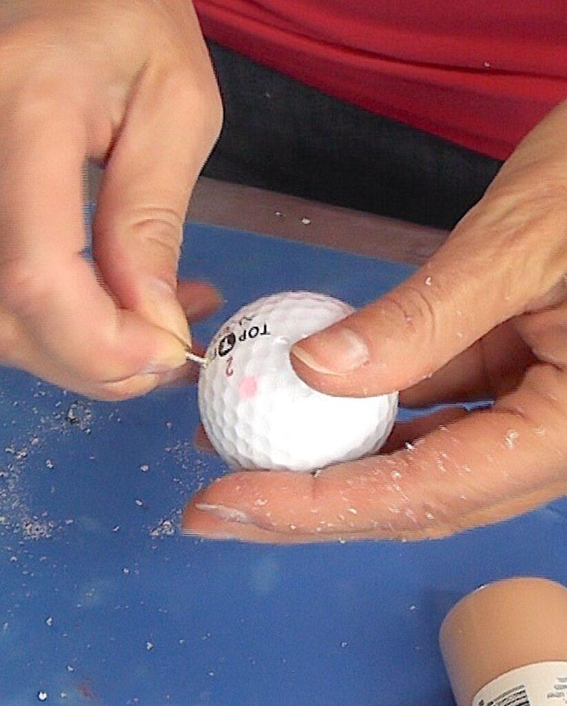 Screw eyescrew into the golf ball