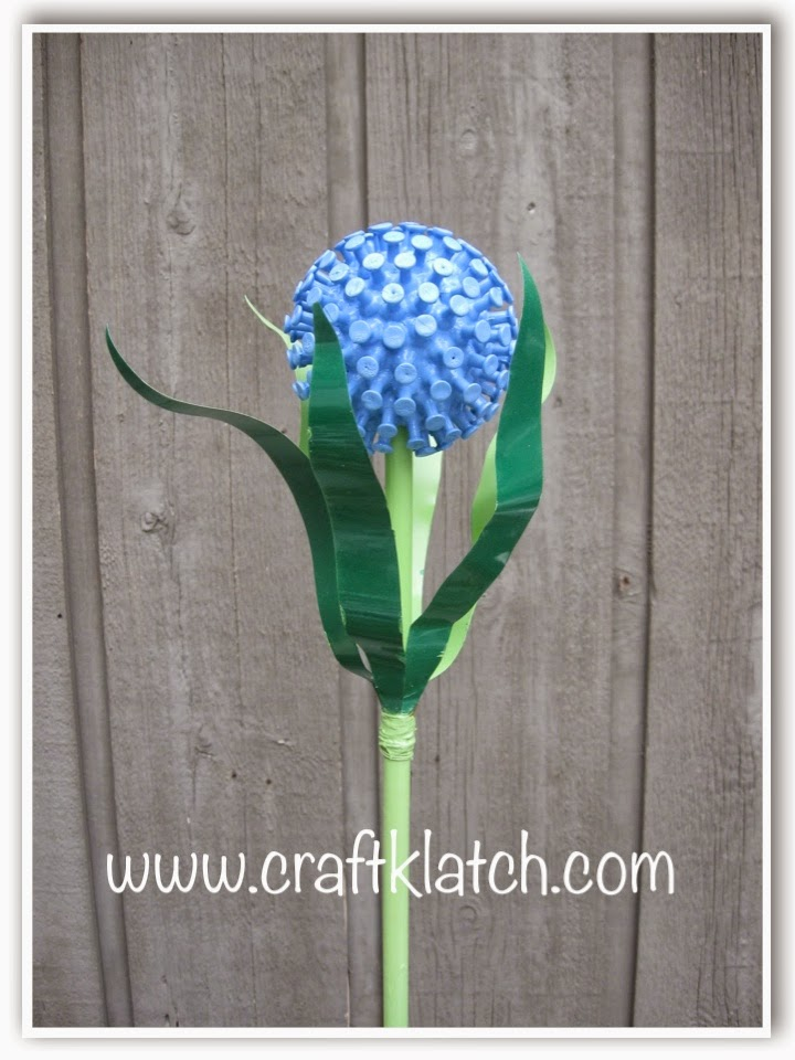 Recycled garden flower in periwinkle blue and green