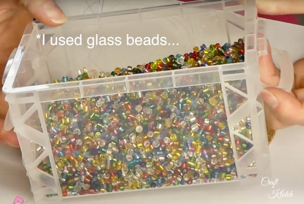 Container of colorful glass beads