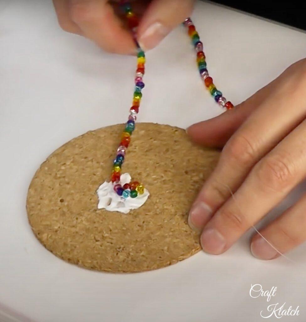 Gluing glass beads to cork round