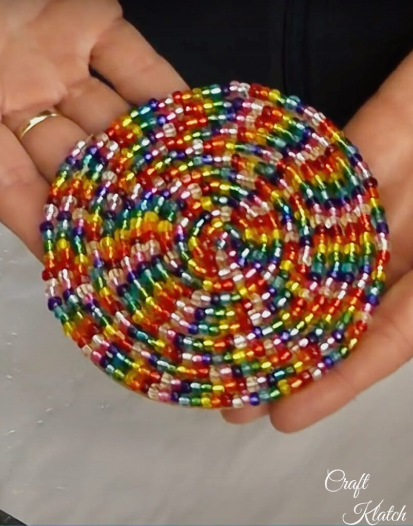 Completed glass beaded coaster with rainbow beads