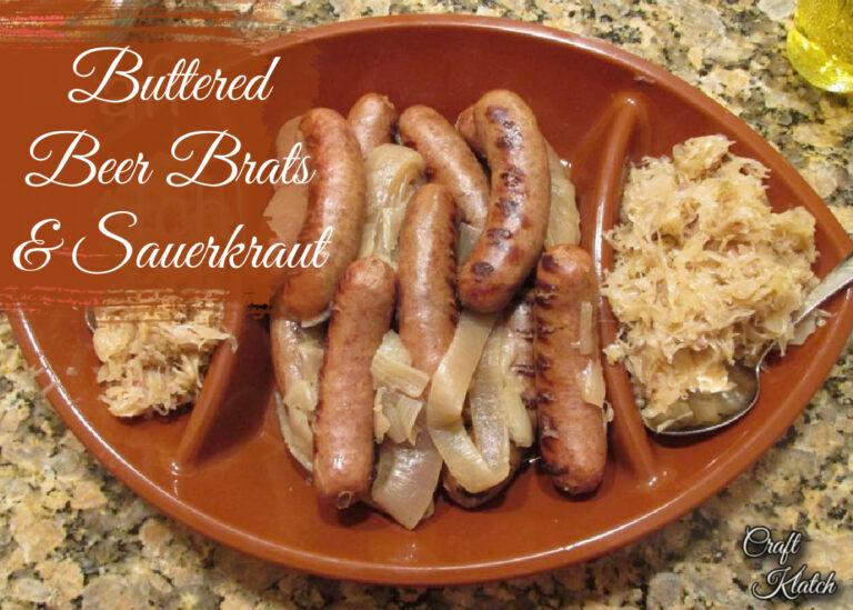 Buttered beer brats and sauerkraut on platter