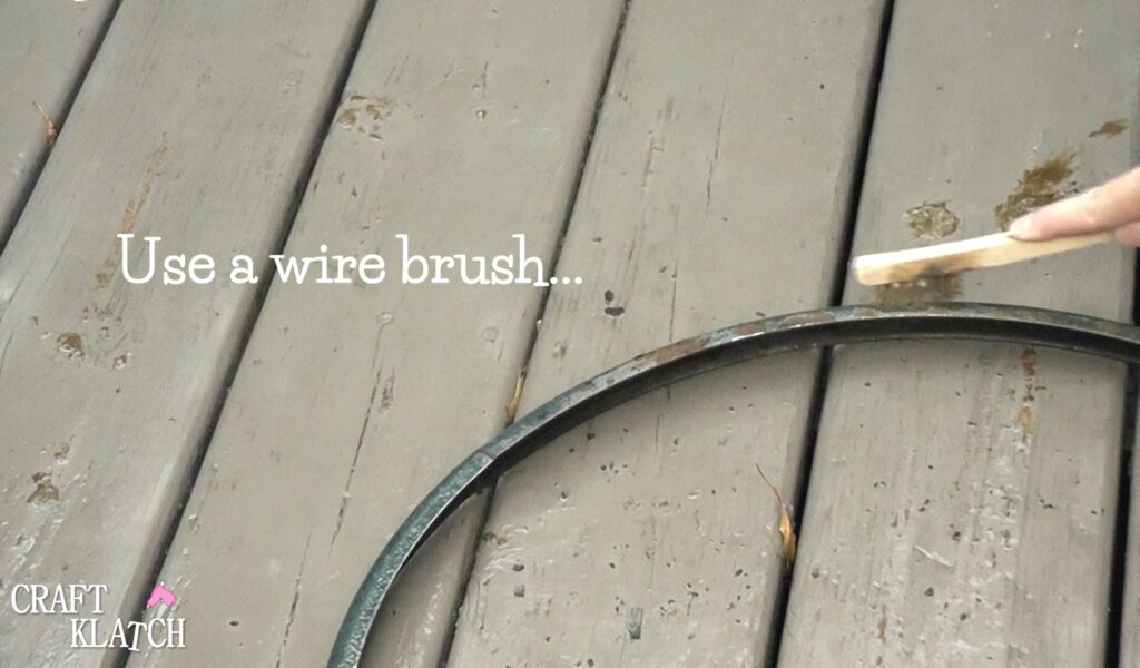 Use a wire brush to finish removing loose paint